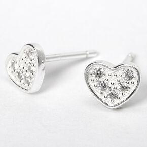 Clous d'oreilles cœurs décorés couleur argentée,