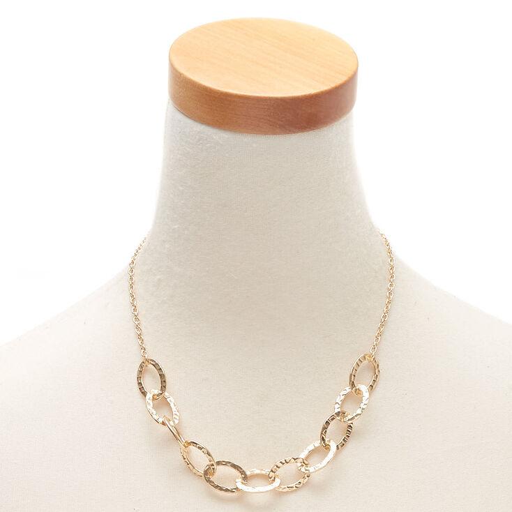 Collier volumineux avec chaîne circulaire martelée couleur doré,