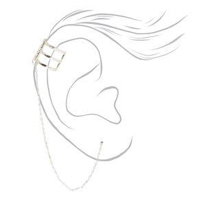Boucle d'oreille traversante reliée à une triple manchette couleur argentée,