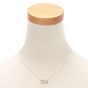 Collier à pendentif symbole de l'infini ornementé couleur argenté,