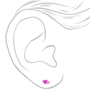 Clous d'oreilles cœur couleur argentée,