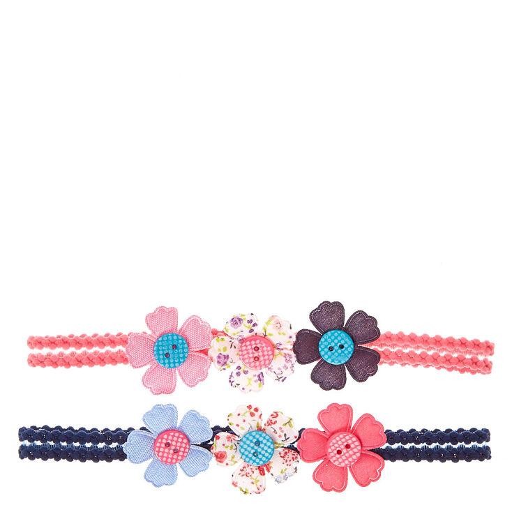 Bandeau avec boutons en forme de fleurs,