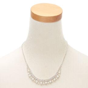 Collier plastron volumineux avec ornement royal,