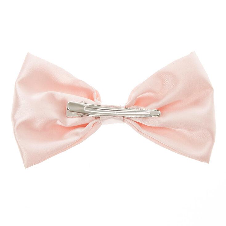 Pince avec nœud satiné rose tendre,