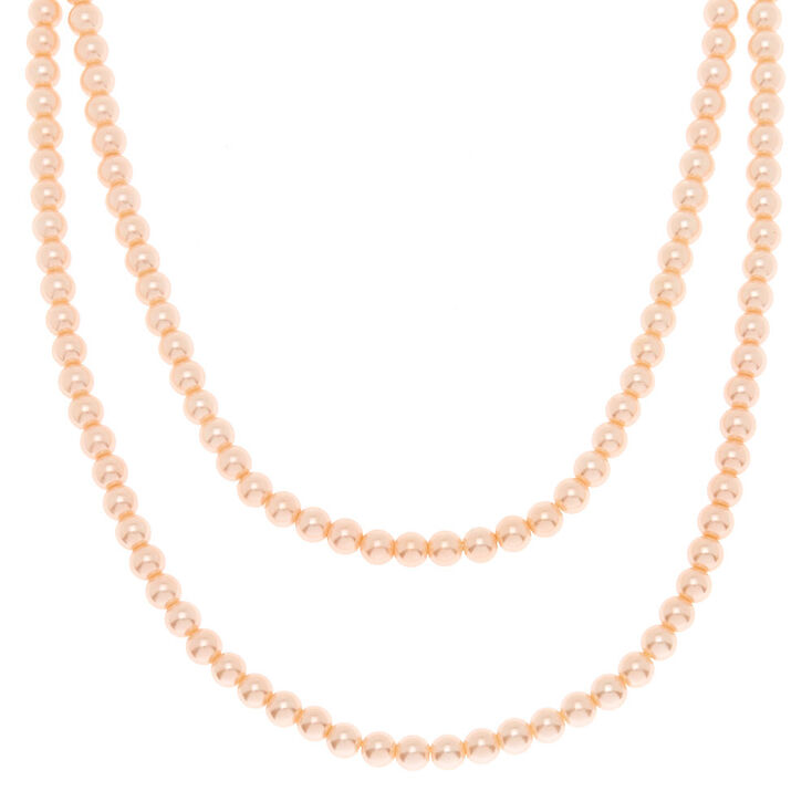Claire's Long collier avec perles d'imitation rose tendre