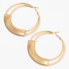 Doubles créoles motif ressort 60mm couleur dorée,