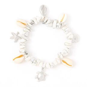 Bracelet élastique coquillages puka breloque océan couleur argentée,