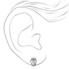 Clous d'oreilles crâne ornés de strass couleur argentée,