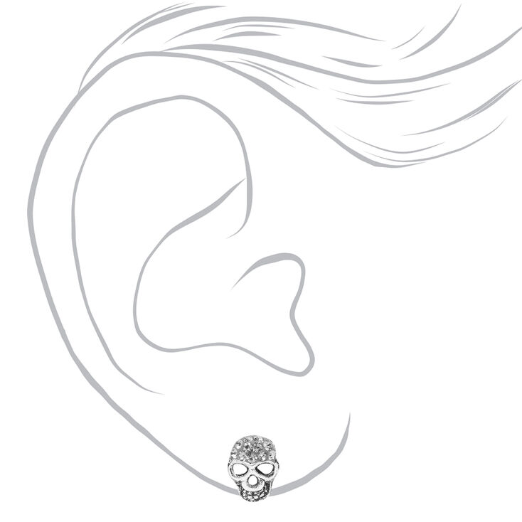 Clous d'oreilles crâne en argent ornés de strass,