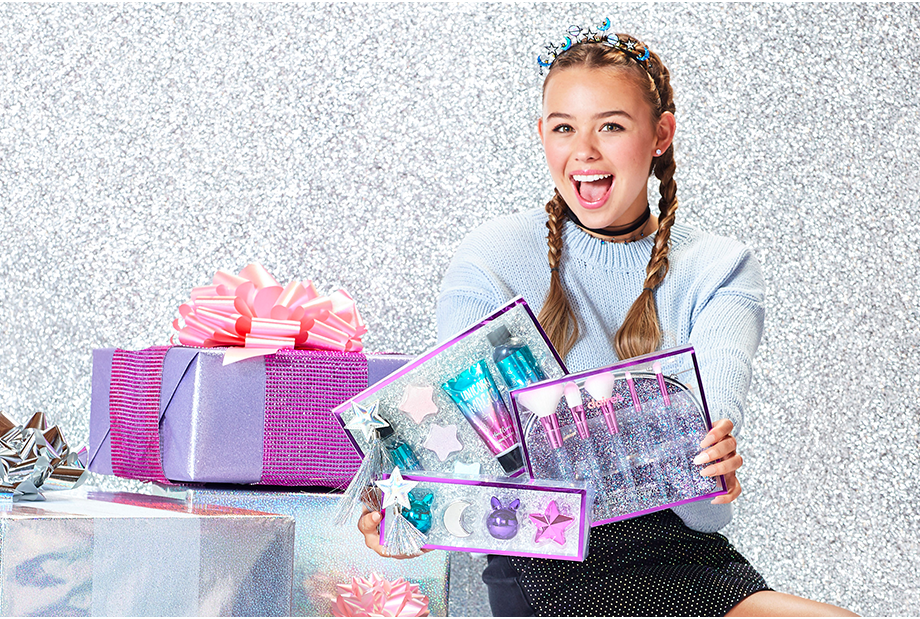 a6c220b1bafc1 girl with presents and beauty gift sets
